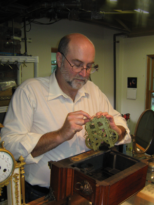 Jack repairing an antique clock