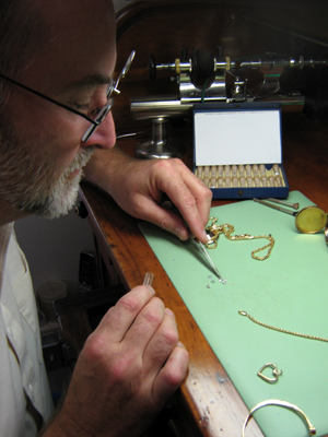 Jack repairing a necklace.